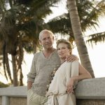 Middle age couple outside on tropcial beach