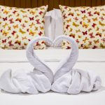 couple's bed with swan towels