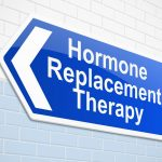 blue hormone replacement therapy sign on tile wall