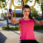 brunette woman working out outdoors