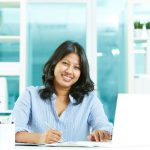 indian women working at desk in office