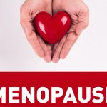 menopause with red heart shape in woman's hand