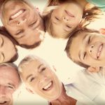 multi-generational family smiling and looking down