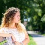 sad woman sitting outside on park bench