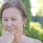More depression reported by women with premature menopause, current HT use