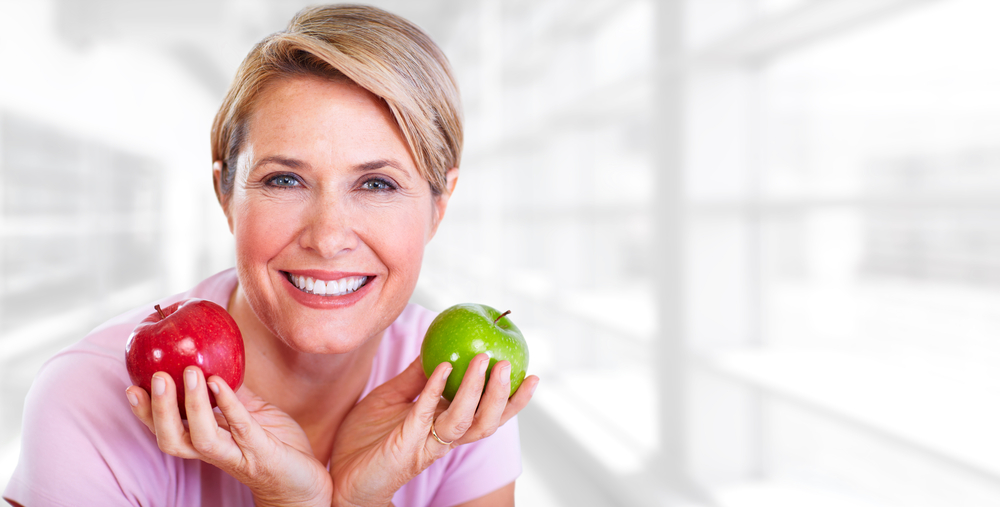 An apple a day might help keep bothersome menopause symptoms away.