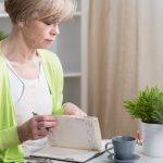 Woman looking at calendar to schedule hysterectomy