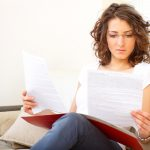 woman filling out paperwork hysterectomy